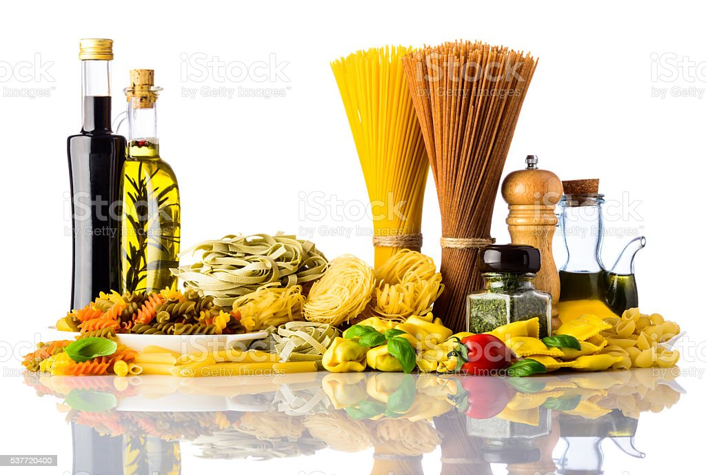 Pasta Types and Cooking Ingredients on White Background stock photo