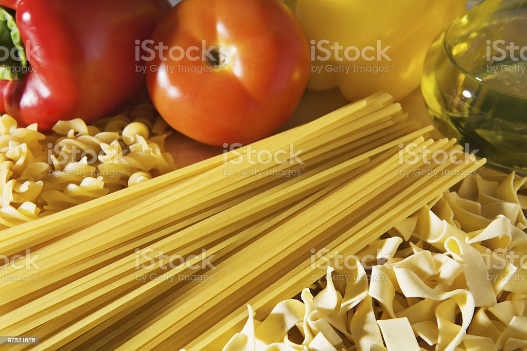 Pasta variety with paprika, tomatoes and oil royalty-free stock photo