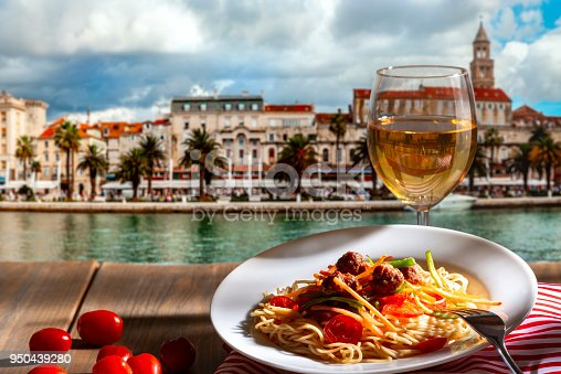 Pasta with a plate of sauce on the table in Croatia, Split.
