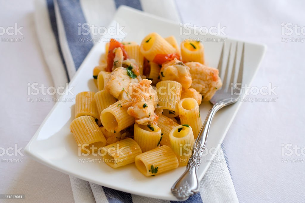 Pasta with Angler Fish and Fresh Tomatoes stock photo