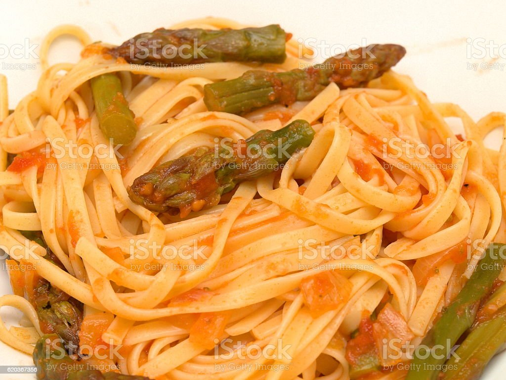 Pasta with asparagus and tomato sauce foto de stock royalty-free