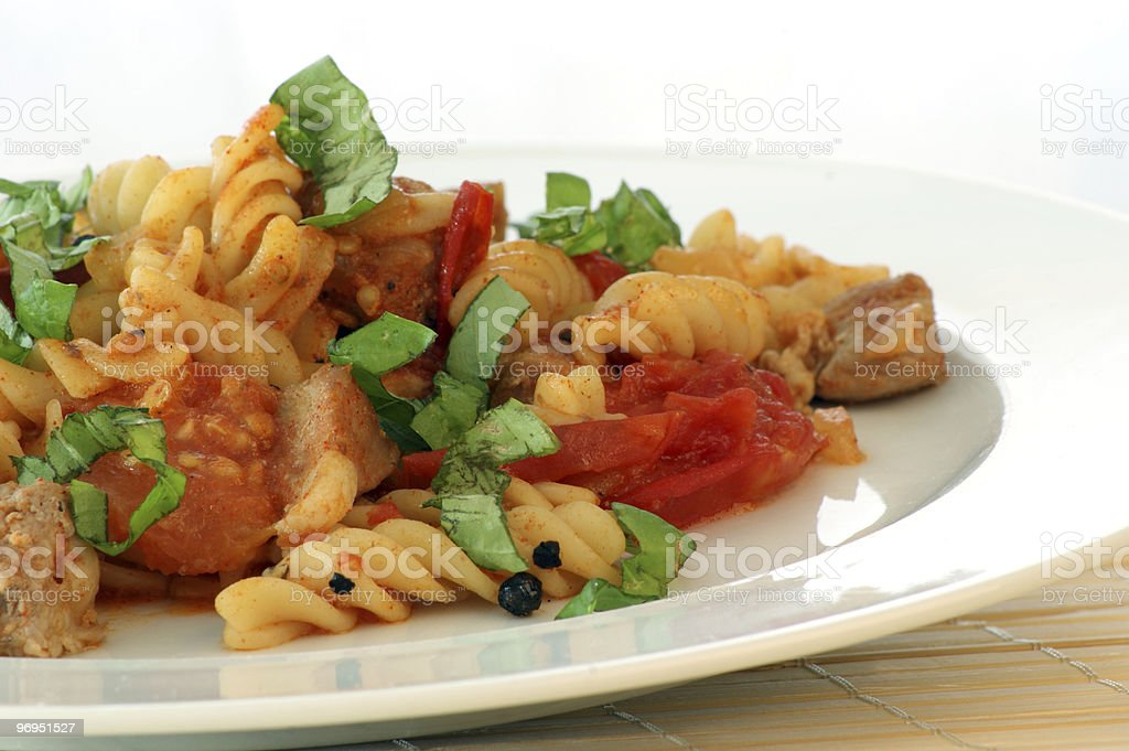 Pasta with baked tomato, meat and basil royalty-free stock photo