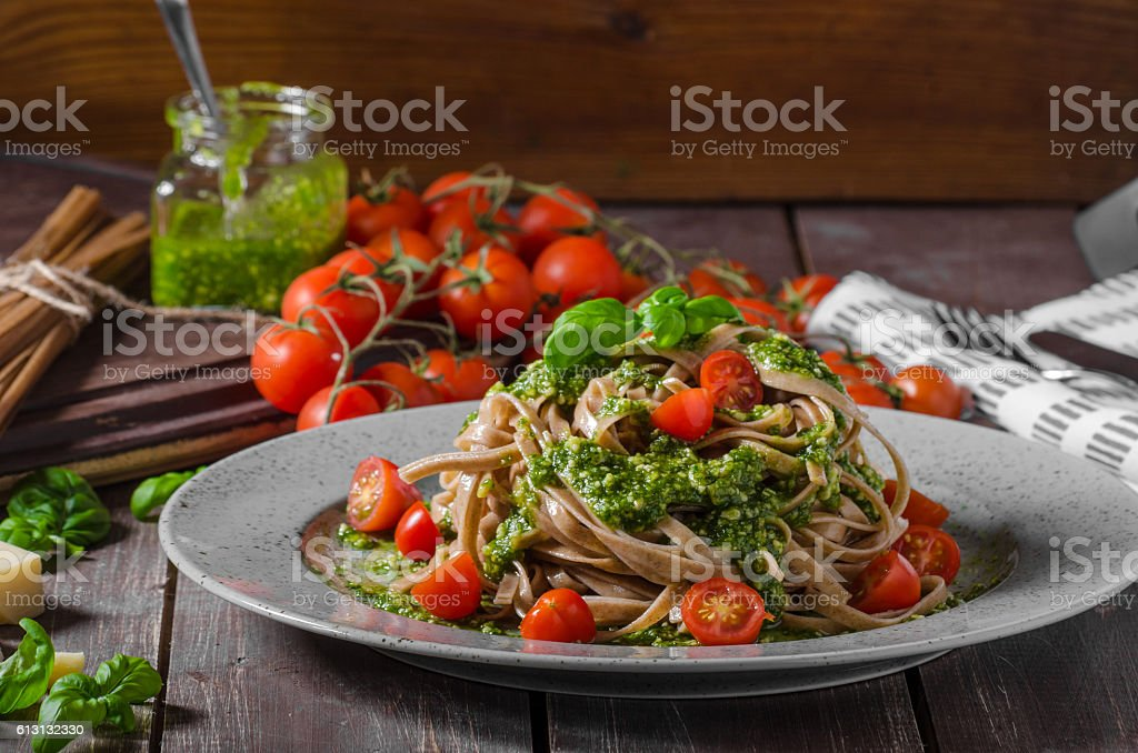 Pasta with basil pesto and parmesan stock photo