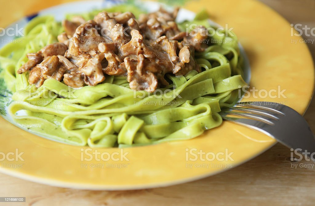 Pasta with basilic and chanterelles royalty-free stock photo