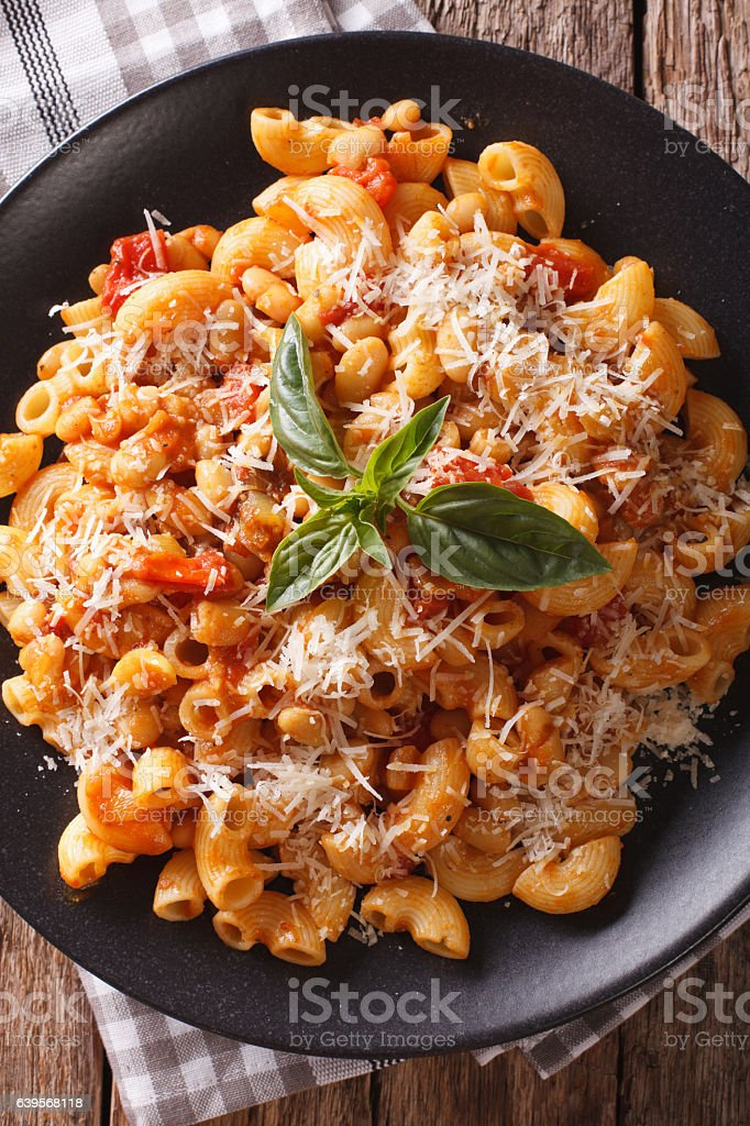 pasta with beans and parmesan close-up. Vertical top view stock photo