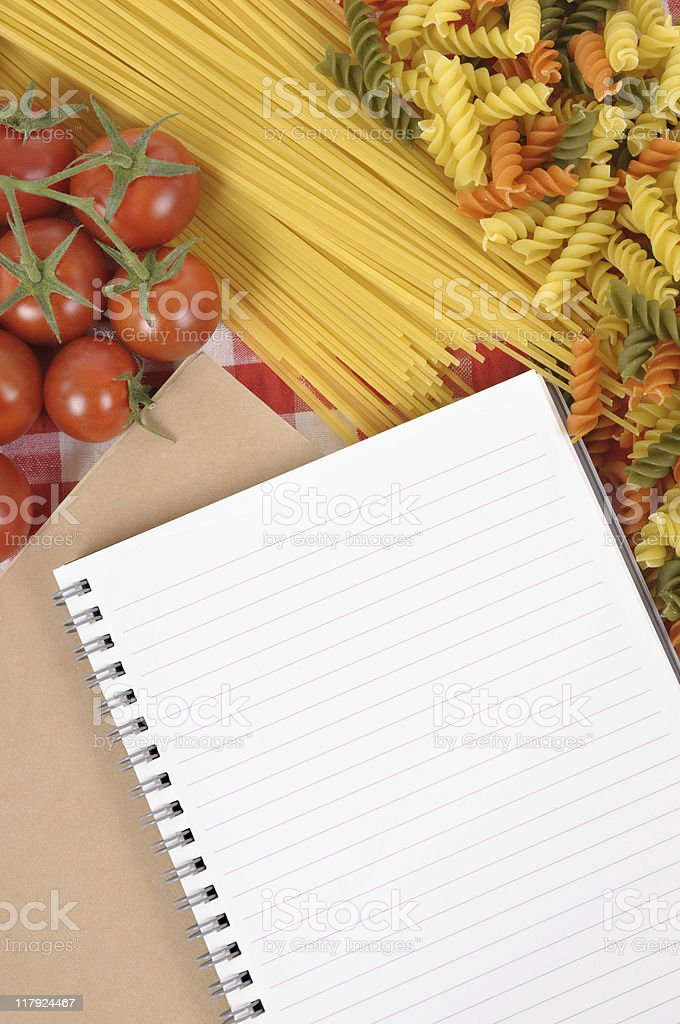 Pasta with blank recipe book royalty-free stock photo