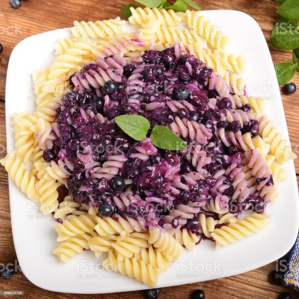 Pasta with blueberries stock photo