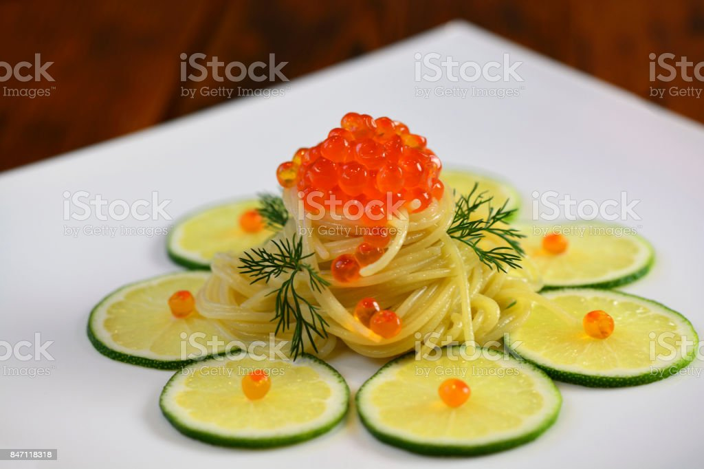 Pasta with caviar and lime stock photo