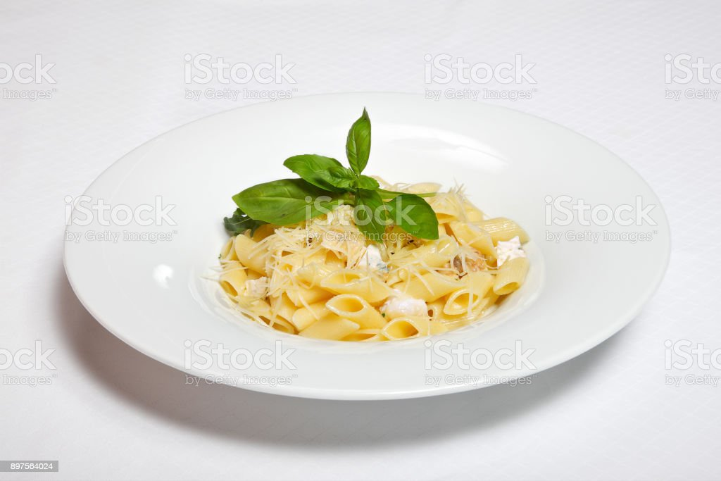pasta with cheese sauce on white stock photo