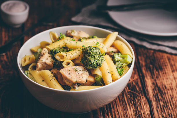 Pasta with chicken and broccoli Creamy whole wheat pasta with chicken and broccoli penne stock pictures, royalty-free photos & images