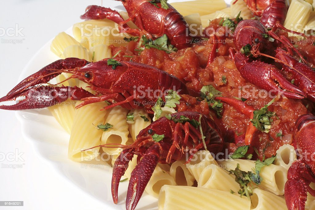 pasta with crawfish and tomato sauce stock photo