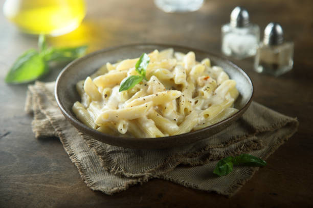 Pasta with cream sauce Creamy pasta with black pepper penne stock pictures, royalty-free photos & images