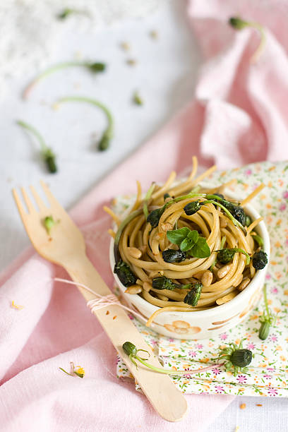 pasta with dandelion flower buds stock photo