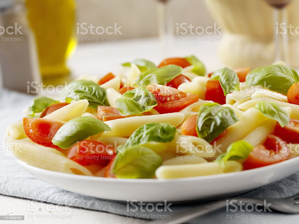 Pasta with Fresh Basil and Tomatoes royalty-free stock photo