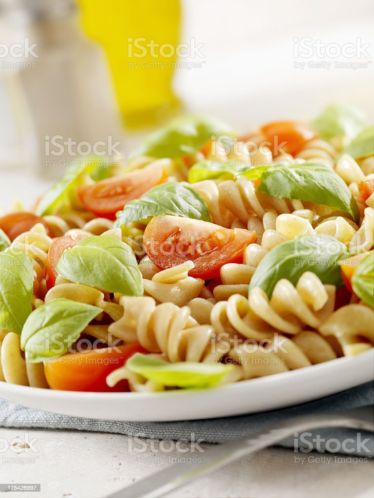 Pasta with Fresh Basil and Tomatoes stock photo
