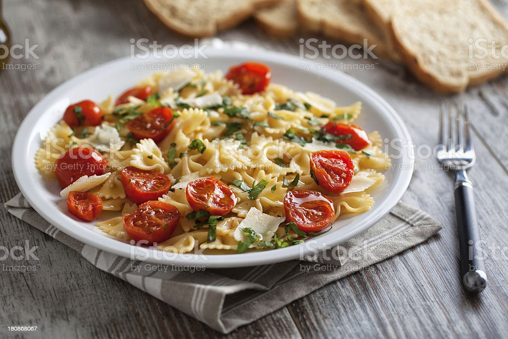 Pasta with fresh tomatoes and basil stock photo