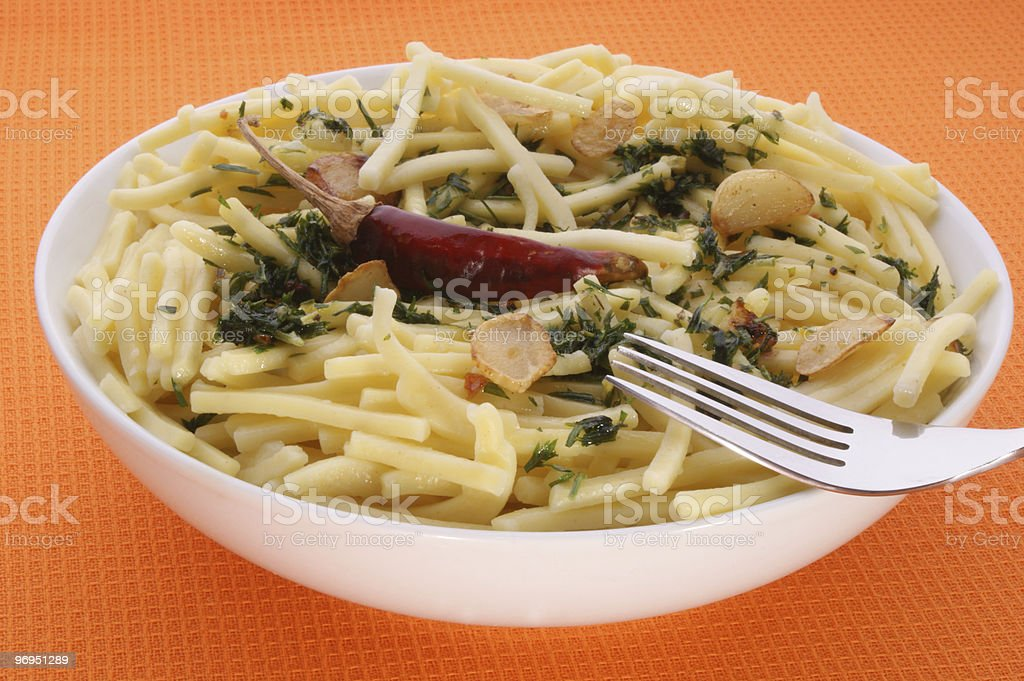 Pasta with garlic and chili in a white bowl royalty-free stock photo