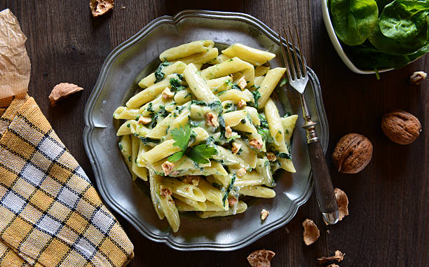 Pasta with gorgonzola Penne pasta with gorgonzola cheese and spinach penne stock pictures, royalty-free photos & images