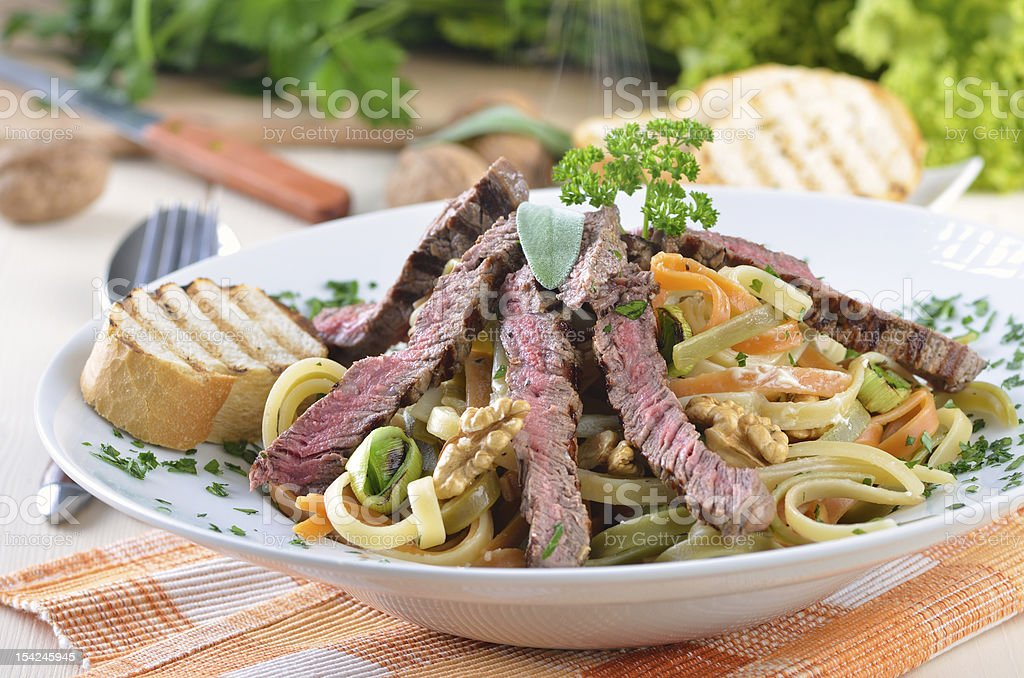 Pasta with grilled beef tenderloin stock photo
