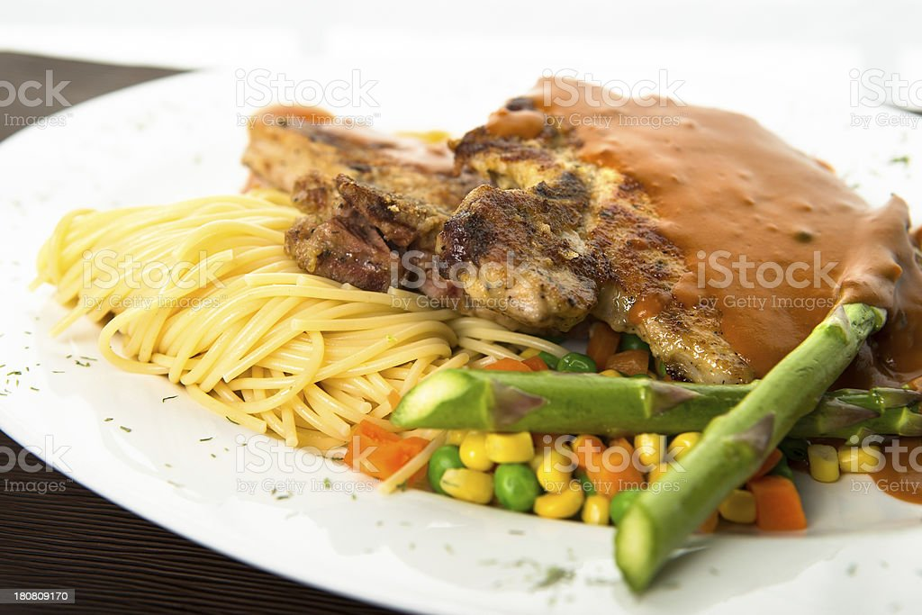 Pasta with grilled pork-chop and vegetable royalty-free stock photo