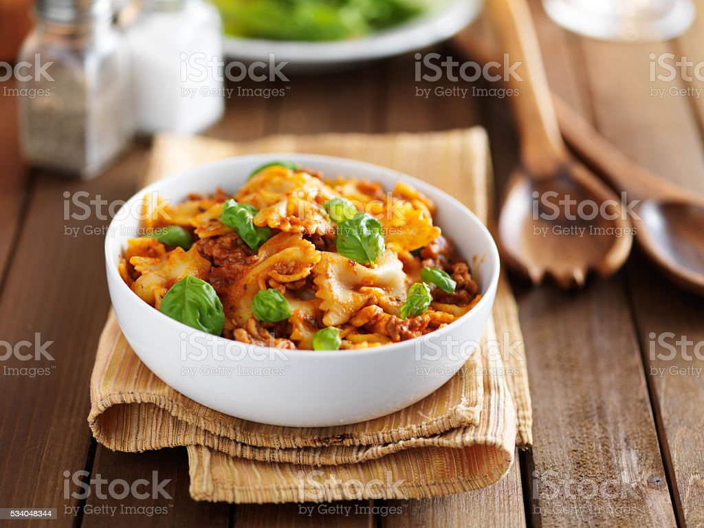 pasta with ground beef and basil stock photo