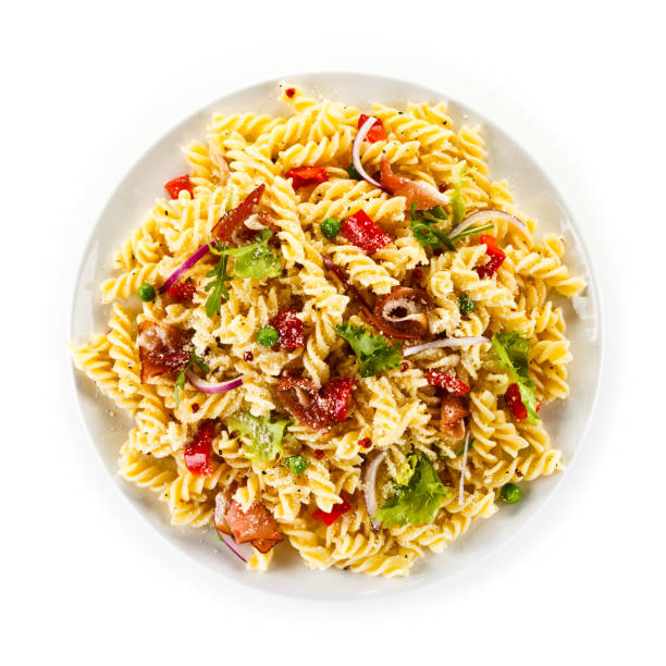 Pasta with ham smoked and vegetables on white background Pasta with ham smoked and vegetables on white background fusilli stock pictures, royalty-free photos & images