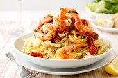 Fresh linguine with king prawns and a tomato and herb sauce.More great images in my food and drink lightbox...