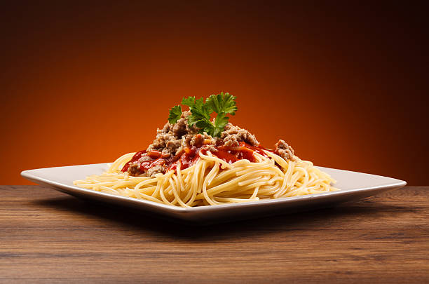 Pasta with meat, tomato sauce and parmesan Pasta with meat and vegetables macaroni stock pictures, royalty-free photos & images