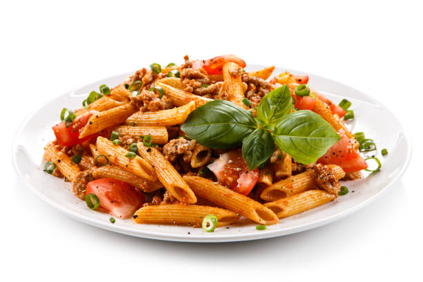 pasta with meat, tomato sauce and vegetables - macarrão imagens e fotografias de stock