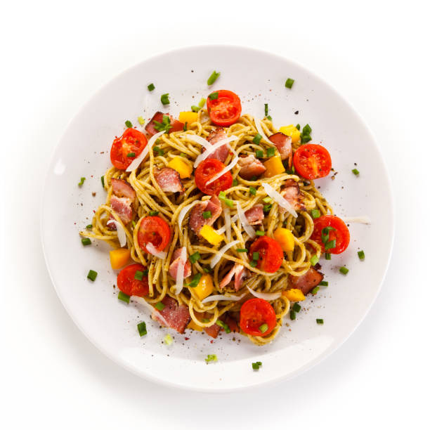 pasta with meat, tomato sauce and vegetables - plate stock pictures, royalty-free photos & images