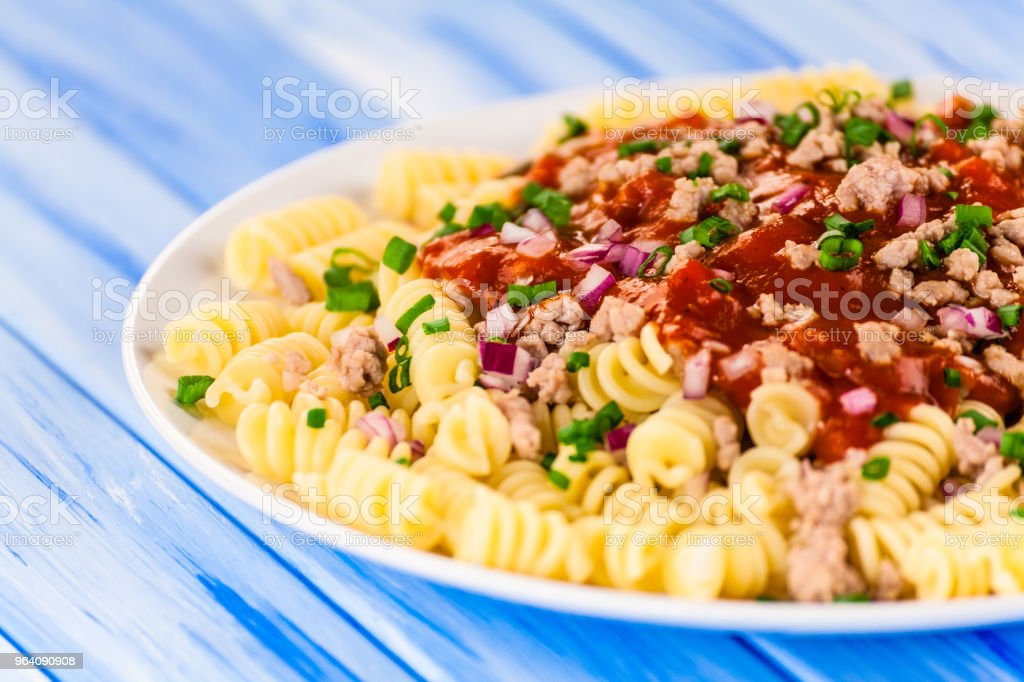 Pasta with meat tomato sauce and vegetables - Royalty-free Bacon Stock Photo