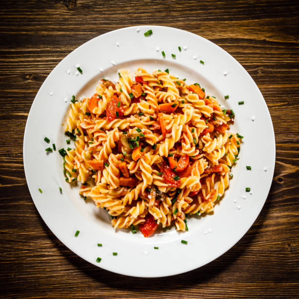 Pasta with meat tomato sauce and vegetables Pasta with meat and vegetables fusilli stock pictures, royalty-free photos & images