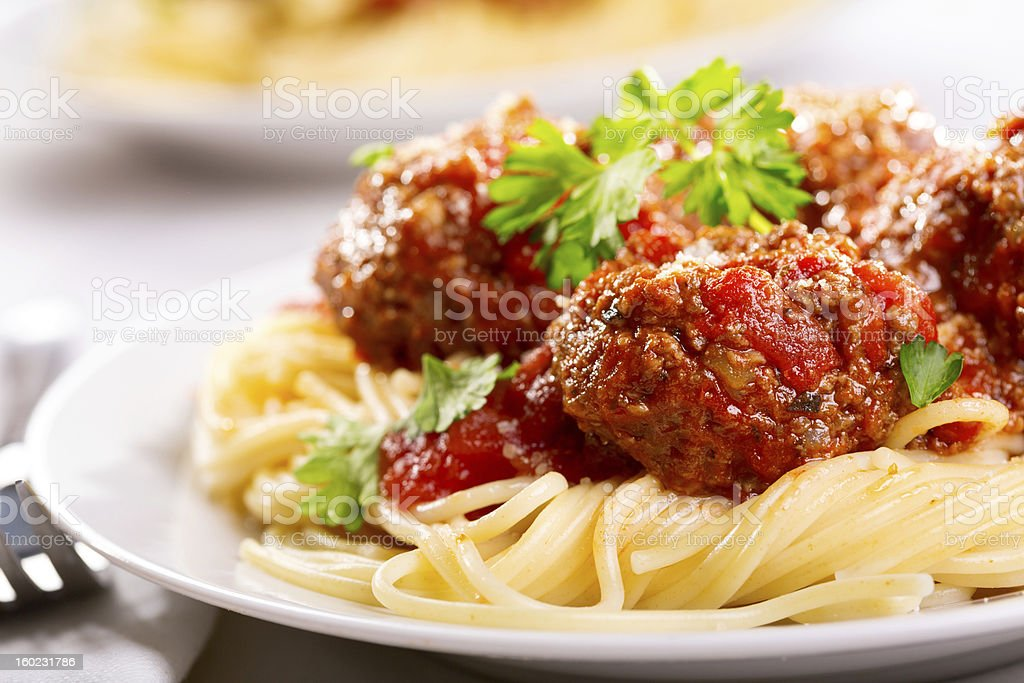 pasta with meatballs and parsley stock photo