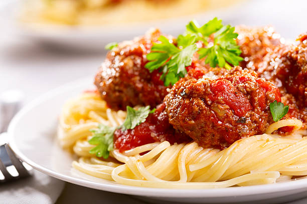 pasta with meatballs and parsley - italian food stock photos and pictures