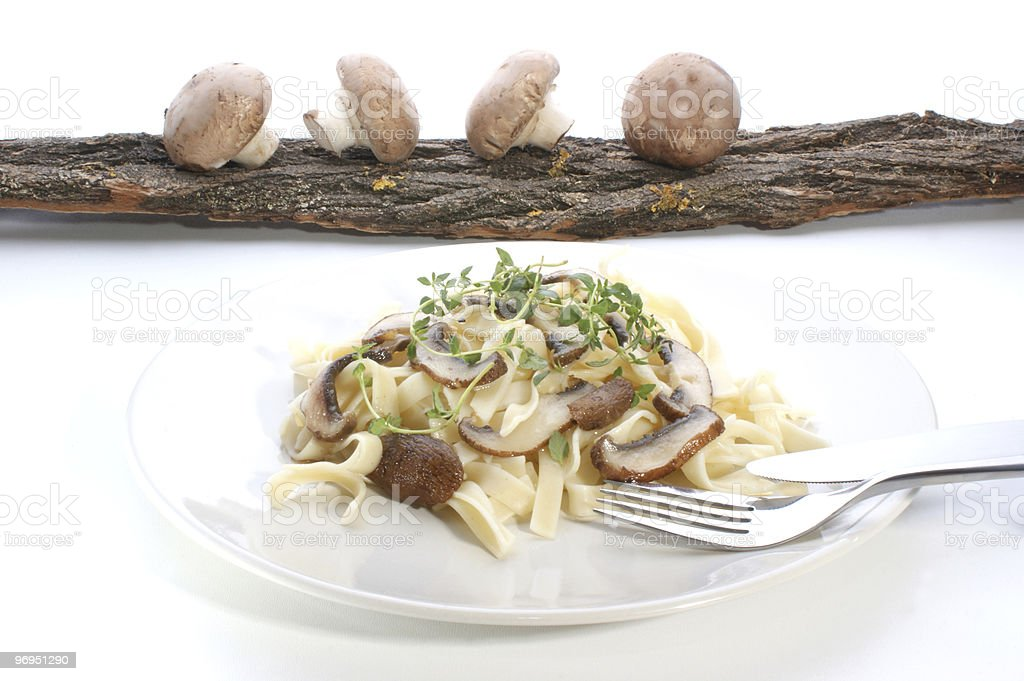 Pasta with mushroom and herbs on a white plate royalty-free stock photo