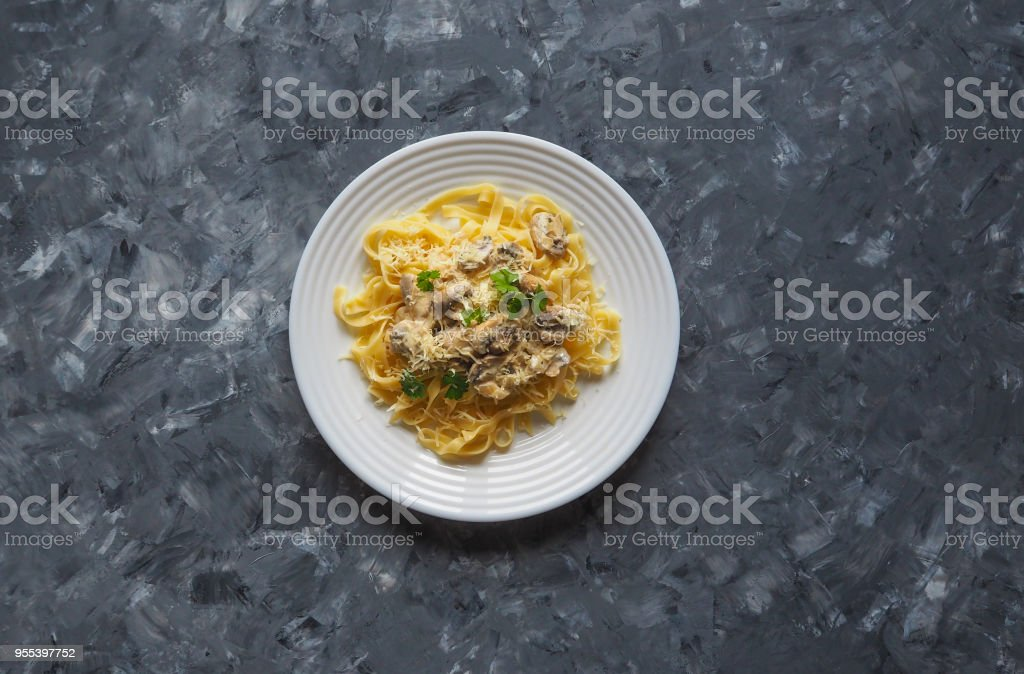 Pasta with mushrooms on a gray background. Copy space for your text. - Zbiór zdjęć royalty-free (Domowy)