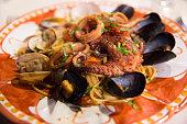 istock Pasta with octopus at italian restaurant in Anacapri 1300862433