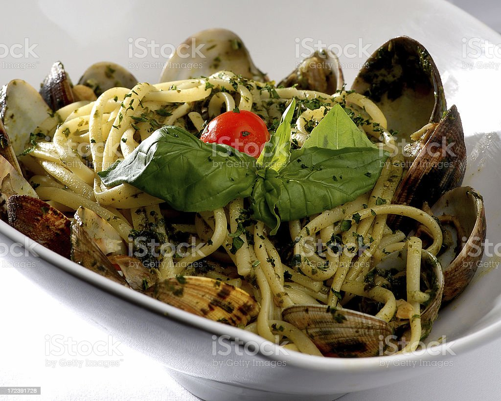 Pasta with pesto sauce and mussle royalty-free stock photo