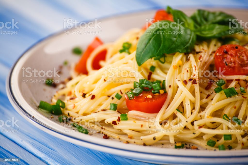 Pasta with pesto sauce and vegetables royalty-free stock photo