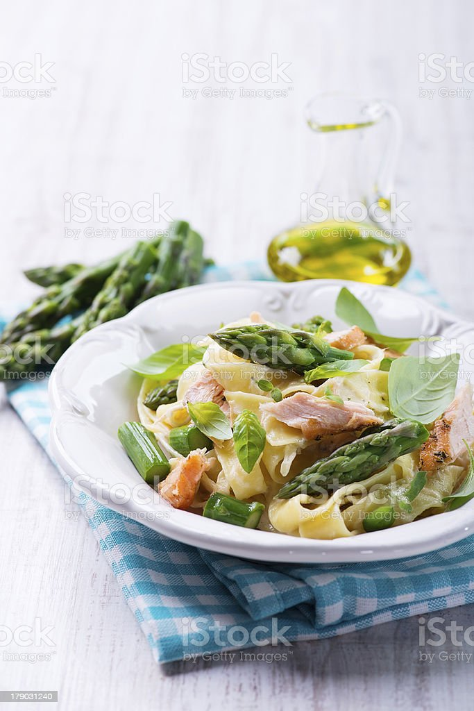 pasta with salmon and green asparagus royalty-free stock photo