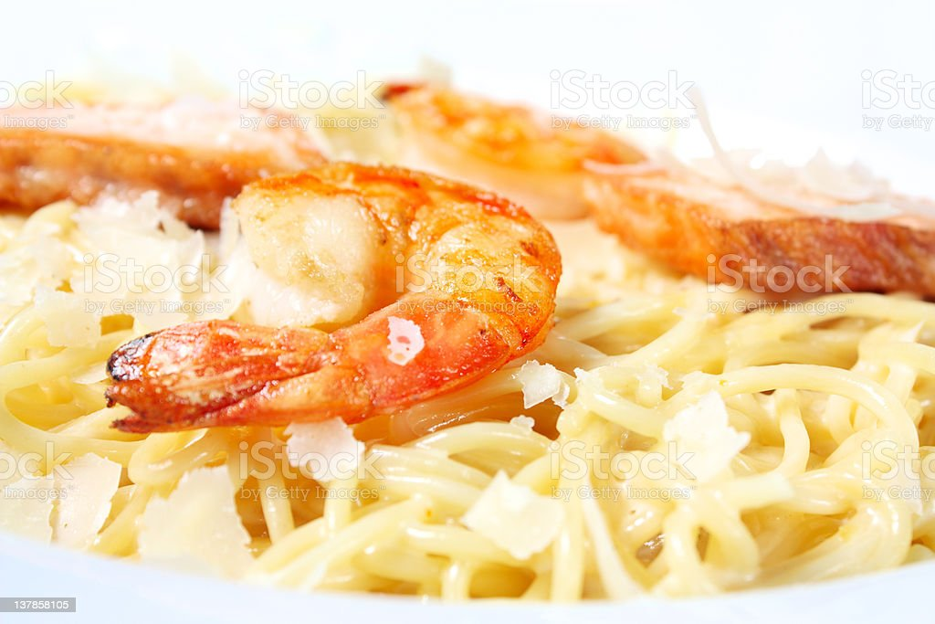 Pasta with salmon and tiger shrimps royalty-free stock photo