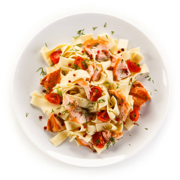 pasta with salmon and vegetables on white background - plate stock pictures, royalty-free photos & images