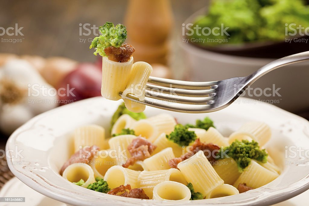 Pasta with sausage and broccoli stock photo