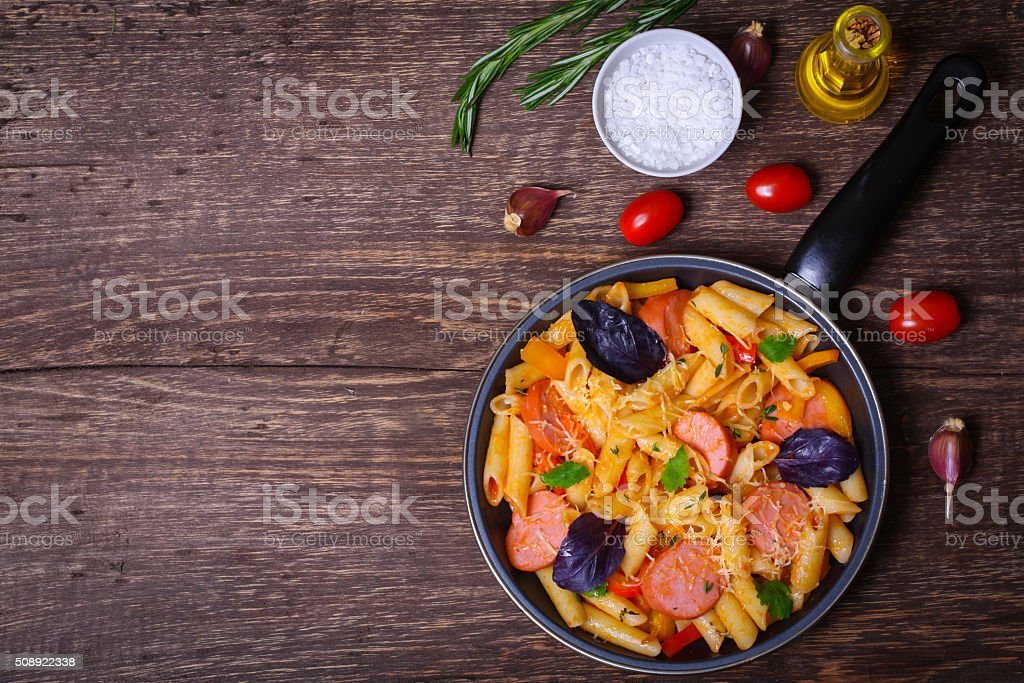 pasta with sausage, peppers, cheese and herbs stock photo
