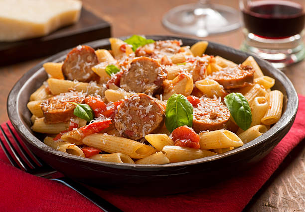 pasta with sausage - sausage stock photos and pictures