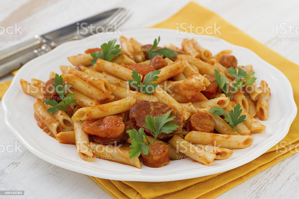 pasta with sausages on the white plate stock photo