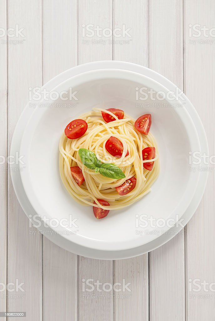 Pasta with tomato and basil royalty-free stock photo