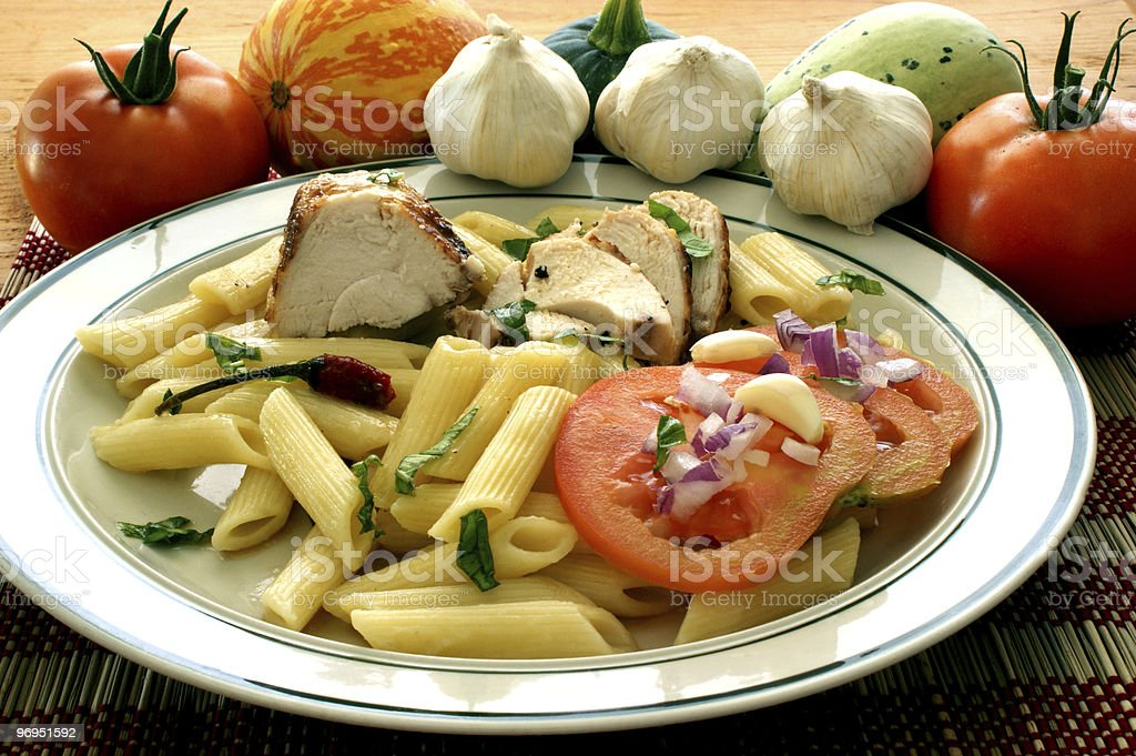 Pasta with tomato and meat on a plate royalty-free stock photo