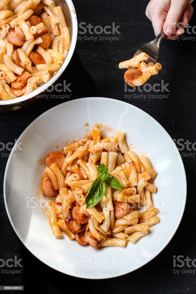 pasta with tomato sauce and basil stock photo