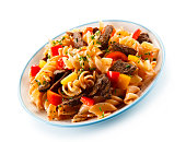 istock Pasta with tomato sauce and grilled beef 1046558880